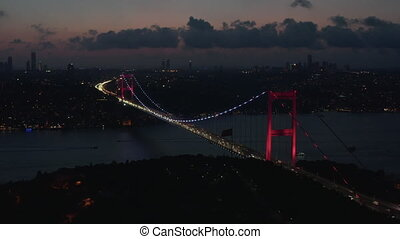 Wide Establishing Shot of Bosphorus Bridge illumination in Red light in Istanbul, Turkey, Aerial