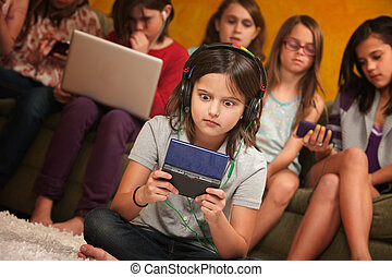 Wide-Eyed Girl - Wide-eyed little girl with headphones and...