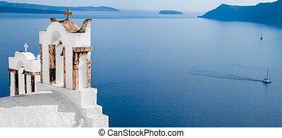 Wide frame view out to sea over the white terrace of Santorini, Cyklade, selective focus