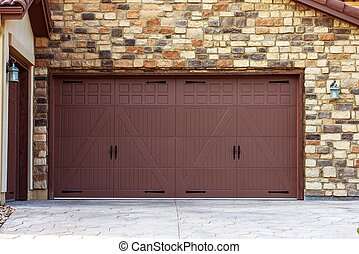 Wide Garage Doors. Brick Wall Garage. Residential...