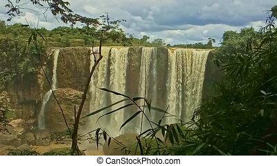 Wide High Powerful Waterfall Cascade among Rocks