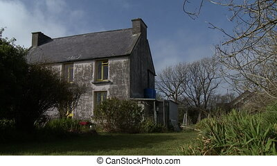 Wide low angle shot of a stone farmhouse - A picturesque ...