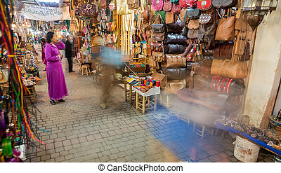 Wide angle view of Fes medina with many shoppings, blurred motion