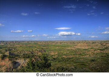 Wide open spaces - Wide open space with blue sky, green...