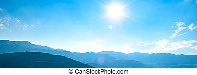 Wide Panorama of Mountains under Bright Sun in the Morning Time