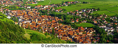 Wide panoramic aerial view of Alsace, Ribeauville. Green valley.