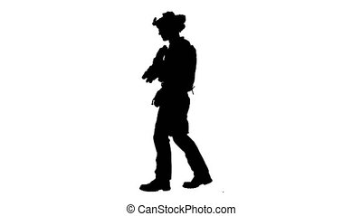 Wide screen. Side view. Armed man in camouflage with a gun walking, Alpha Channel Professional shot in 4K resolution. 048. You can use it e.g. in your medical, commercial video, business, presentation, broadcast
