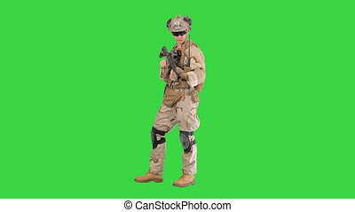 Wide screen. Side view. United states Marine Standing And Talking on a Green Screen, Chroma Key. Professional shot in 4K resolution. 048. You can use it e.g. in your medical, commercial video, business, presentation, broadcast