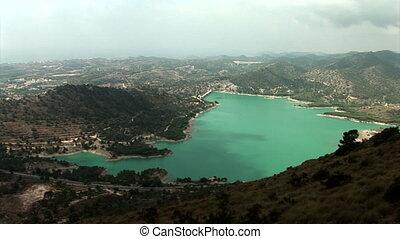 """Wide shoot from above of water reservoir """"Embalse de Amadorio"""" in Orxeta, Spain."""