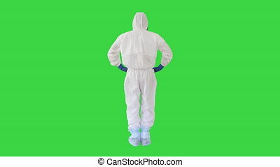 Wide shot. Back view. Man in a white decontamination suit putting hand on his head Bad situation on a Green Screen, Chroma Key. Professional shot in 4K resolution. 53. You can use it e.g. in your medical, commercial video, business, presentation, broadcast