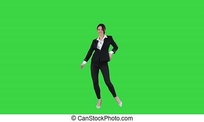 Brunette businesswoman dancing on a Green Screen, Chroma...