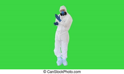 Doctor in hazamat protective suit dancing in a funny way Covid-19 concept on a Green Screen, Chroma Key.