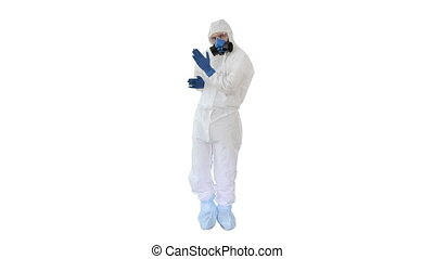 Doctor in hazamat protective suit dancing in a funny way Covid-19 concept on white background.