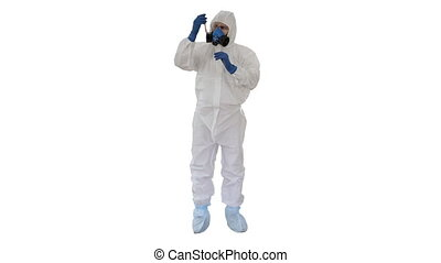 Wide shot. Doctor in Hazmat Suit and Gas Mask Holding Test Tube of Blood on white background. Professional shot in 4K resolution. 53. You can use it e.g. in your medical, commercial video, business, presentation, broadcast