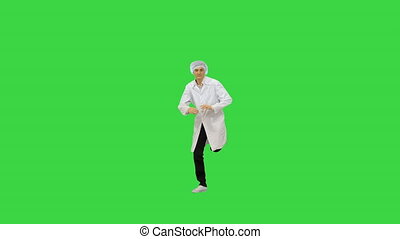 Doctor in medical clothes break dancing on a Green Screen, Chroma Key.