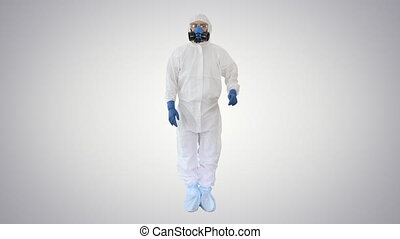 Doctor or scientist in hazard suit presenting something pointing imaginary objects on the sides on gradient background.