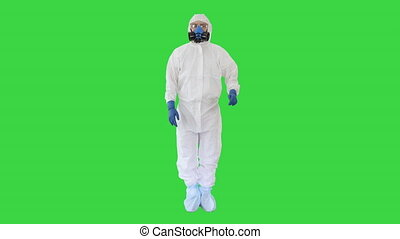 Doctor or scientist in hazard suit presenting something pointing imaginary objects on the sides on a Green Screen, Chroma Key.