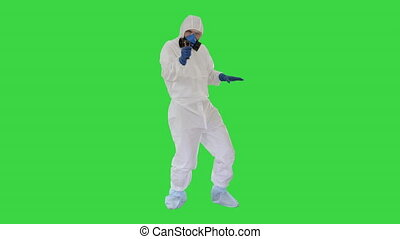 Wide shot. Doctor with infrared thermometer James Bond intro parody on a Green Screen, Chroma Key. Professional shot in 4K resolution. 53. You can use it e.g. in your medical, commercial video, business, presentation, broadcast