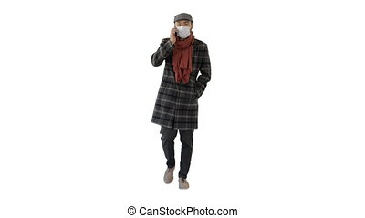 Wide shot. Fashionable gentleman in medical mask calling on the phone on white background. Professional shot in 4K resolution. 53. You can use it e.g. in your medical, commercial video, business, presentation, broadcast