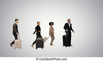 Four diverse business people with luggage checking info ...