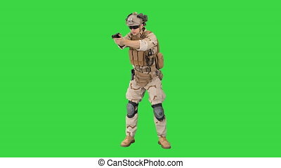 Wide shot. Front view. Army man pointing gun in multiple directions ready for combat on a Green Screen, Chroma Key. Professional shot in 4K resolution. 048. You can use it e.g. in your medical, commercial video, business, presentation, broadcast