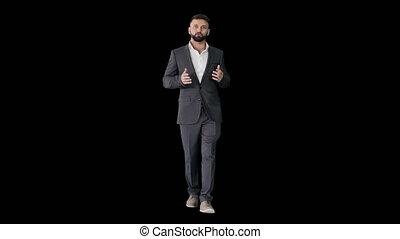 Bearded turk businessman walking and talking to camera, ...