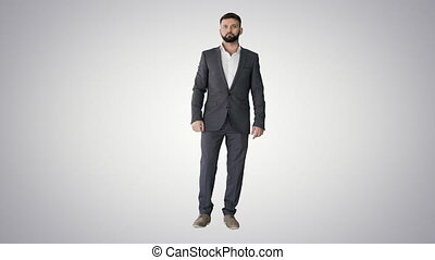 Businessman with a beard showing gestures Finger up, thumbs up on gradient background.