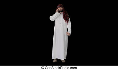 Wide shot. Front view. Emirate Arabian UAE Sheikh businessman making a call, Alpha Channel. Professional shot in 4K resolution. 044. You can use it e.g. in your medical, commercial video, business, presentation, broadcast
