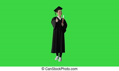 Wide shot. Front view. Happy graduate woman holding diploma and thumb up on a Green Screen, Chroma Key. Professional shot in 4K resolution. 043. You can use it e.g. in your medical, commercial video, business, presentation, broadcast
