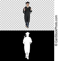 Happy graduation student walking to the graduation ceremony, Alp