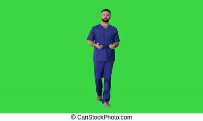 Male doctor surgeon talking while walking on a Green Screen, Chroma Key.