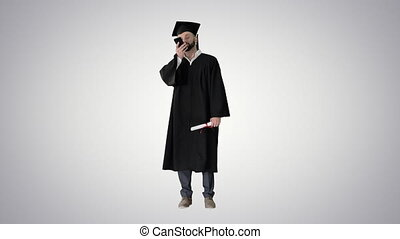 Wide shot. Front view. Mature man graduate student recording voice message on gradient background. Professional shot in 4K resolution. 044. You can use it e.g. in your medical, commercial video, business, presentation, broadcast