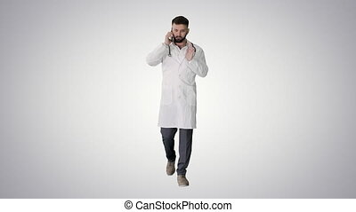 Medical doctor calling by phone walking on gradient background.
