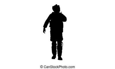 Wide shot. Front view. Ranger walks, holds a radio station and gives orders, Alpha Channel Professional shot in 4K resolution. 048. You can use it e.g. in your medical, commercial video, business, presentation, broadcast