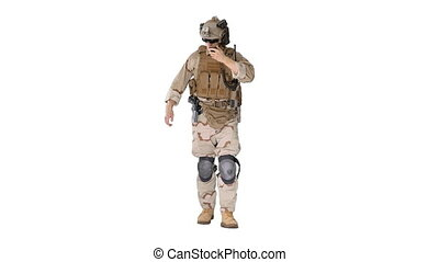 Wide shot. Front view. Ranger walks, holds a radio station and gives orders on white background. Professional shot in 4K resolution. 048. You can use it e.g. in your medical, commercial video, business, presentation, broadcast
