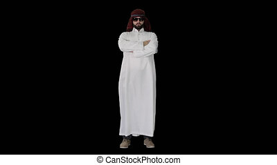 Wide shot. Front view. Sheikh in sunglasses sending a kiss, Alpha Channel. Professional shot in 4K resolution. 044. You can use it e.g. in your medical, commercial video, business, presentation, broadcast