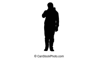 Wide shot. Front view. Silhouette Cool teenager boy in casual clothes wearing medical mask. Professional shot in 4K resolution. 062. You can use it e.g. in your medical, commercial video, business, presentation, broadcast