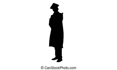 Wide shot. Front view. Silhouette Happy male student in graduation robe posing and waiving with his diploma. Professional shot in 4K resolution. 047. You can use it e.g. in your medical, commercial video, business, presentation, broadcast