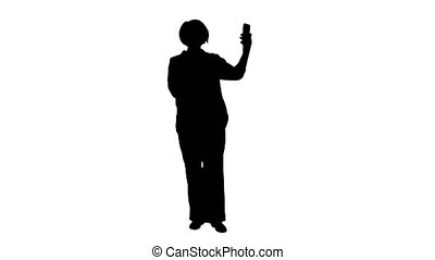 Wide shot. Front view. Silhouette Intelligent grandma taking a selfie. Professional shot in 4K resolution. 063. You can use it e.g. in your medical, commercial video, business, presentation, broadcast