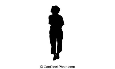Wide shot. Front view. Silhouette Walking clown playing the trumpet. Professional shot in 4K resolution. 061. You can use it e.g. in your medical, commercial video, business, presentation, broadcast
