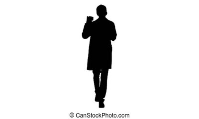 Wide shot. Front view. Silhouette Walking Male Doctor showing empty white box of pills. Professional shot in 4K resolution. 047. You can use it e.g. in your medical, commercial video, business, presentation, broadcast