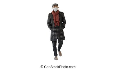Gentleman with medical face mask walking on white background.