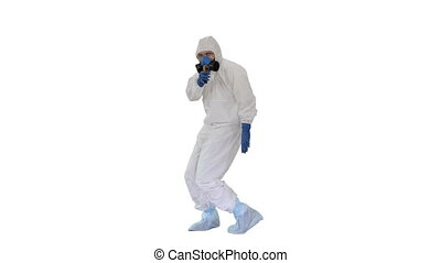 Wide shot. James Bond parody Doctor wearing gloves with biohazard chemical protective suit checking temperature on white background. Professional shot in 4K resolution. 53. You can use it e.g. in your medical, commercial video, business, presentation, broadcast