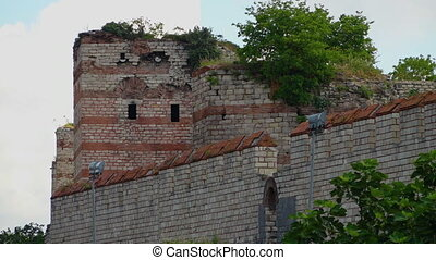 Theodosian Walls of Constantinople overgrown with vegetation...