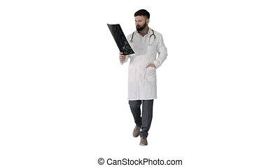 Wide shot. Male turk physician walking and reviewing a MRI brain scan on white background. Professional shot in 4K resolution. 4151. You can use it e.g. in your commercial video, business, presentation, broadcast