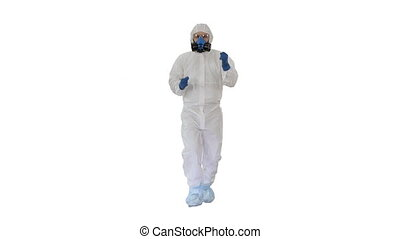 Wide shot. Man in hazamat suit walking and dancing Covid-19 concept on white background. Professional shot in 4K resolution. 53. You can use it e.g. in your medical, commercial video, business, presentation, broadcast