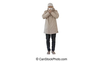 Wide shot. Man in top clothes and in medical disposable mask coughing on white background. Professional shot in 4K resolution. 53. You can use it e.g. in your medical, commercial video, business, presentation, broadcast