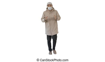 Wide shot. Man in winter outfit and medical mask talking to you explaining something while walking on white background. Professional shot in 4K resolution. 53. You can use it e.g. in your medical, commercial video, business, presentation, broadcast