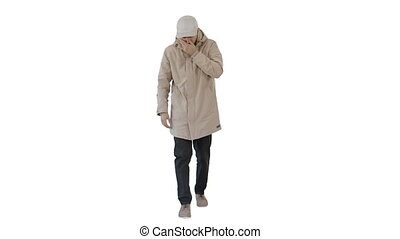 Wide shot. Man in winter outfit walking and coughing on white background. Professional shot in 4K resolution. 53. You can use it e.g. in your medical, commercial video, business, presentation, broadcast
