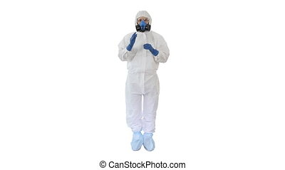 Wide shot. Man Wearing HAZMAT Protective Clothing Showing That He Wears Gloves on white background. Professional shot in 4K resolution. 53. You can use it e.g. in your medical, commercial video, business, presentation, broadcast